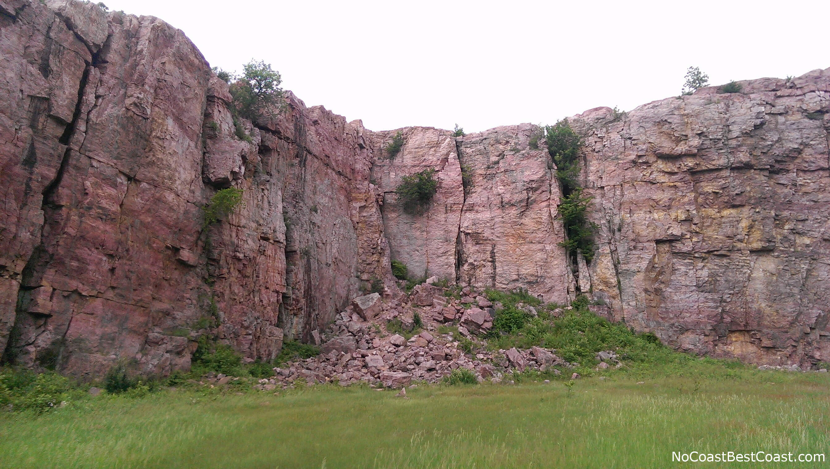 The pink Sioux Quartzite cliffs of the historic quarry