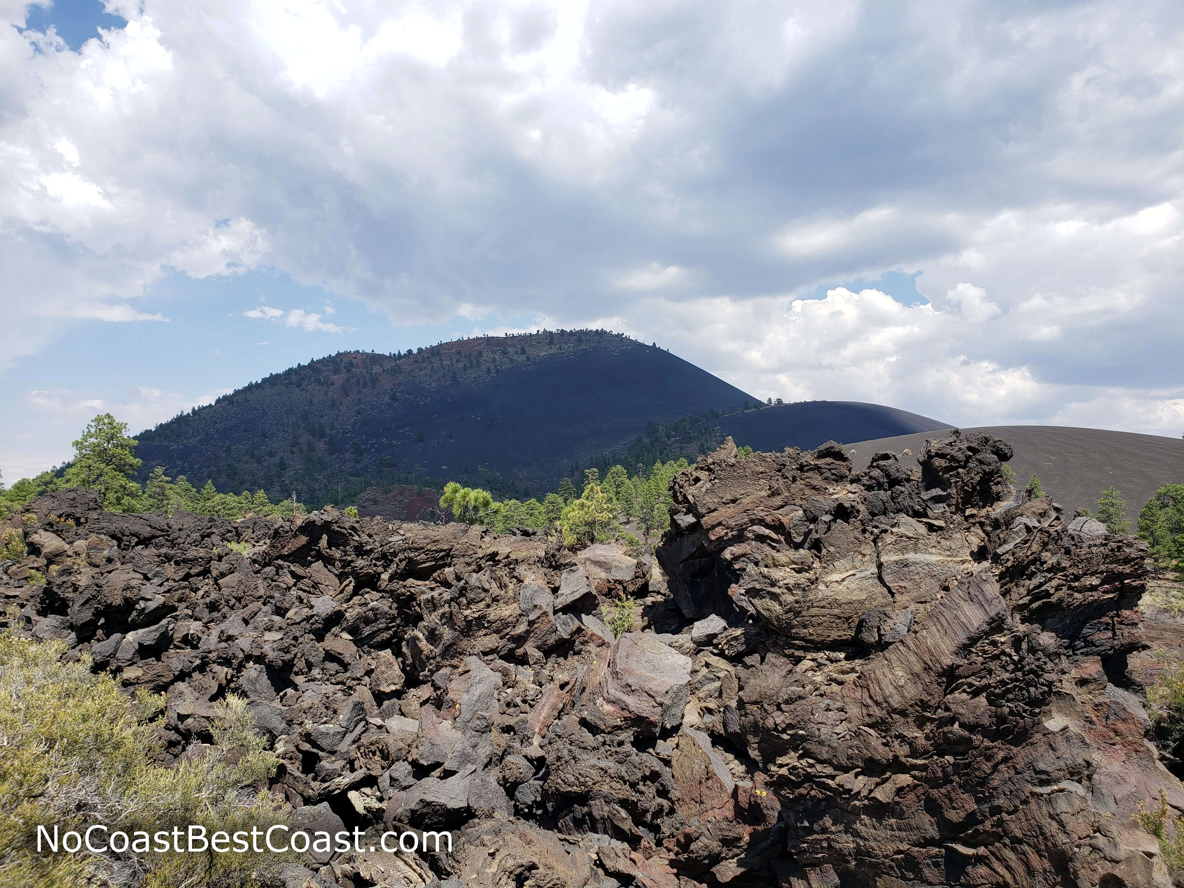 Basalt formations with Sunset Crater in the background