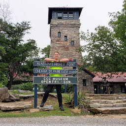 The sign, observation tower, and CCC Museum at the summit of Cheaha Mountain