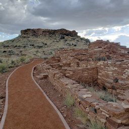 Citadel Pueblo on top of the hill with Nalakihu Pueblo in the foreground