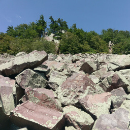 Looking up at the boulders on the southern slope of the East Bluff