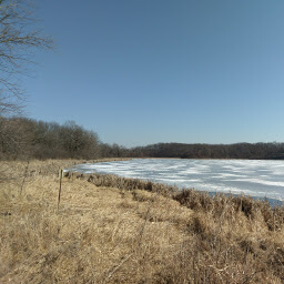 A view across the partially frozen Goose Lake.