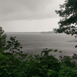 Peeking through the forest at the stormy waters of Mille Lacs Lake