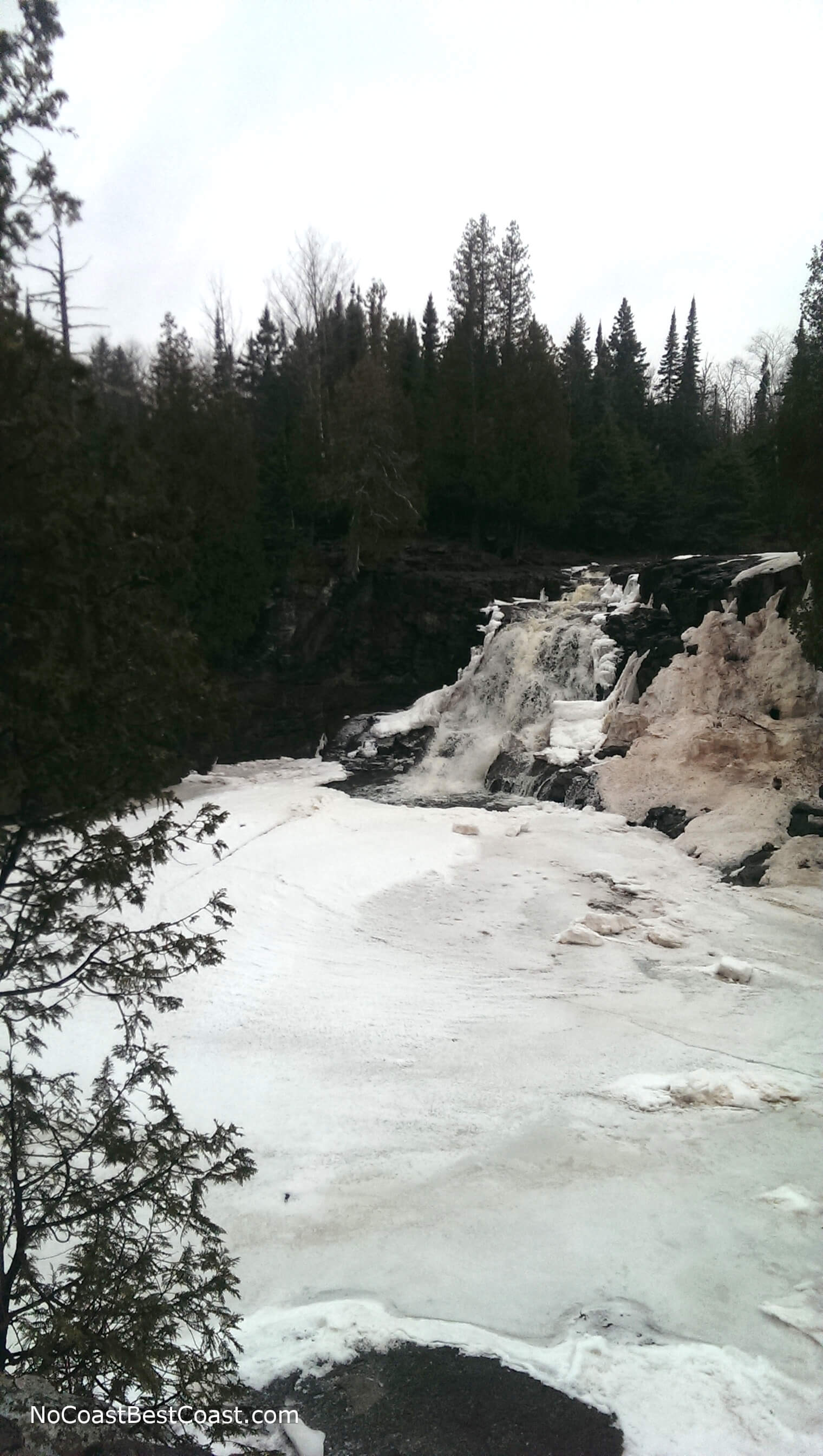 Viewing the frozen waterfall from the trail