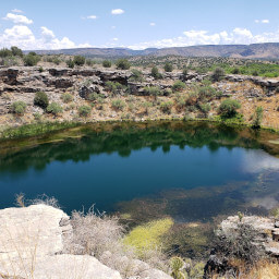 The blue of Montezuma Well contrasting with the brown desert
