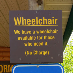 Sign stating a wheelchair is available free of charge