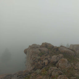 Fog dowsing the rock formations at the summit of Sheepnose Mountain