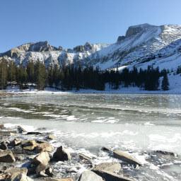 Stella Lake frozen solid with snowy Wheeler Peak above