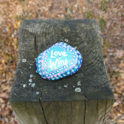 A brightly painted rock left by another hiker