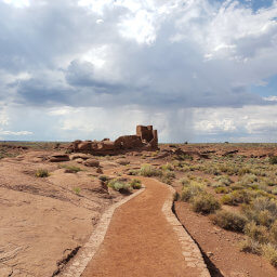 Wukoki Pueblo rising above the desert as seen from the start of the trail